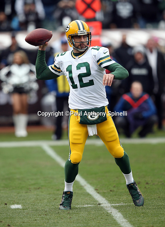 Green Bay Packers quarterback Aaron Rodgers (12) throws a pass during the 2015 week 15 regular season NFL football game against the Oakland Raiders on Sunday, Dec. 20, 2015 in Oakland, Calif. The Packers won the game 30-20. (©Paul Anthony Spinelli)