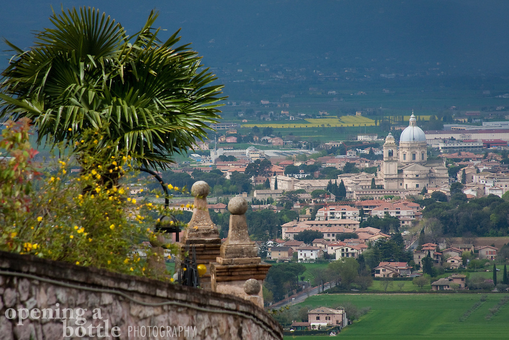 The Basilica of Santa Maria degli Angeli, a sacred site for the Franciscan Order, rises below the city of Assisi, Umbria, Italy.