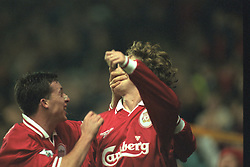Liverpool, England - Wednesday, November 27th, 1996: Liverpool's Steve McManaman celebrates scoring the opening goal with team-mate Robbie Fowler during the 4-2 victory over Arsenal during the 4th Round of the League Cup at Anfield. (Pic by David Rawcliffe/Propaganda)