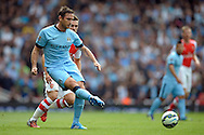 Manchester City's Frank Lampard passing the ball. Barclays Premier league match, Arsenal v Manchester city at the Emirates Stadium in London on Saturday 13th Sept 2014.<br /> pic by John Patrick Fletcher, Andrew Orchard sports photography.