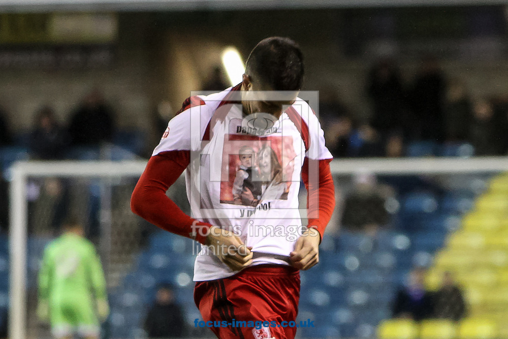 Picture by Daniel Chesterton/Focus Images Ltd +44 7966 018899<br /> 21/12/2013<br /> Emmanuel Ledesma of Middlesbrough celebrates after scoring his side's first goal with a t-shirt for teammate Mark Parnaby during the Sky Bet Championship match at The Den, London.