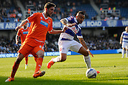 Queens Park Rangers Danny Simpson competing with Blackpool's Chris Basham. Skybet football league championship match , Queens Park Rangers v Blackpool at Loftus Road in London  on Saturday 29th March 2014.<br /> pic by John Fletcher, Andrew Orchard sports photography.