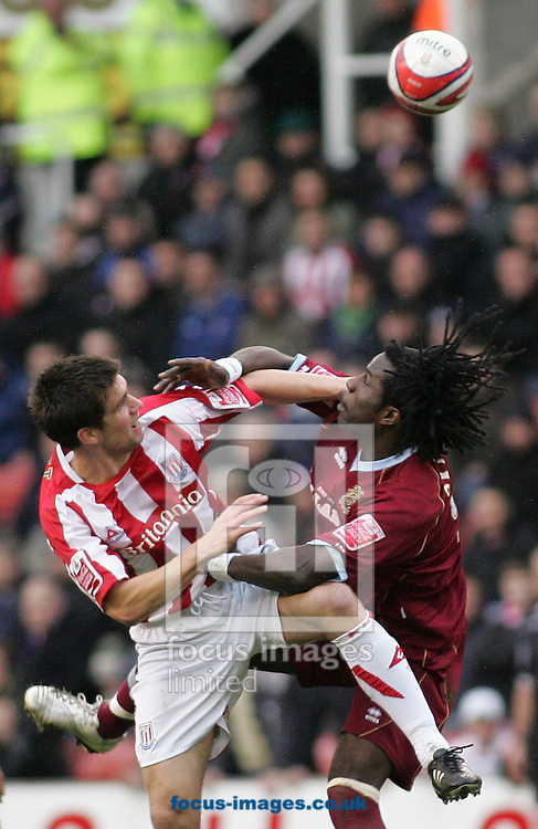 Stoke - Saturday March 8th, 2008: Chris Riggott of Stoke City in action against Ade Akinbiyi of Burnley during the Coca Cola Championship match at The Brittania Stadium, Stoke. (Pic by Micheal Sedgwick/Focus Images)
