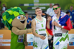 Lipko, official mascot, with Bostjan Nachbar #10 of Slovenia and Edo Muric #8 of Slovenia after basketball match between national team of Slovenia and Ukraine in 5th Place game at Day 18 of Eurobasket 2013 on September 21, 2013 in SRC Stozice, Ljubljana, Slovenia. (Photo By Matic Klansek Velej / Sportida.com)