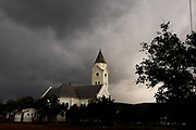 Storm clouds gather over a church in McGregor, two hours North East of Cape town.