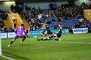 Mansfield Town midfielder CJ Hamilton (22) shoots at goal  during the EFL Sky Bet League 2 match between Mansfield Town and Grimsby Town FC at the One Call Stadium, Mansfield, England on 4 January 2020.