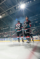 KELOWNA, CANADA - OCTOBER 18:  MacKenzie Johnston #22 and Tyrell Goulbourne #12 of the Kelowna Rockets take part in a pre-game ritual on the ice as the Prince George Cougars visit the Kelowna Rockets on October 18, 2012 at Prospera Place in Kelowna, British Columbia, Canada (Photo by Marissa Baecker/Shoot the Breeze) *** Local Caption ***