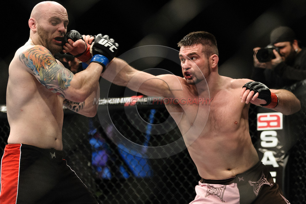 "BIRMINGHAM, ENGLAND, NOVEMBER 5, 2012: Justin Edwards (left) is stunned by a right jab from John Maguire during ""UFC 138: Munoz vs. Leben"" inside the National Indoor Arena in Birmingham, United Kingdom"