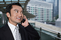 China Hong Kong business man using mobile phone standing on footbridge close up