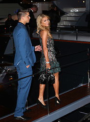 Paris Hilton and boyfriend River Viiperi attend Roberto Cavalli's boat party at the Cannes Film Festival. France. 15/05/2013<br />