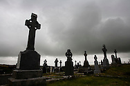 Cemetery with Celtic Cross headstones on stormy day in Co. Clare, Ireland. on Monday, July 2, 2007. (Photo/John Froschauer).