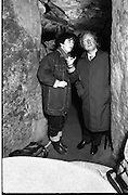 Taoiseach Visits Newgrange.  (R70)..1987..21.12.1987..12.21.1987..21st December 1987..An Taoiseach, Charles Haughey TD, visited the Newgrange Stoneage Chamber to view thwe annual Winter Soltice. As the sun rose, An Taoiseach watched as the sunrise traced its path along the floor of the chamber...A newgrange tour guide explains the layout ,construction and design of the mound containing the Newgrange chamber.