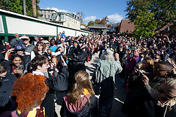 Harry Potter annd fellow characters are welcomed by hundreds as they arrive at Hogsmeade Station (formally know as Chestnut Hill West), to attend the sixth annual Harry Potter Fan Festival, on Saturday. (Bastiaan Slabbers/for PhillyVoice)