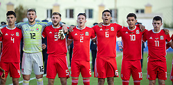 ORHEI, MOLDOVA - Friday, October 11, 2019: Wales players line-up for the national anthem before the UEFA Under-21 Championship Italy 2019 Qualifying Group 9 match between Moldova and Wales at the Orhei District Sports Complex. L-R captain Jack Evans, goalkeeper Adam Przybek, Brandon Cooper, Cameron Coxe, Benjamin Cabango, Brennan Johnson, Nathan Broadhead. (Pic by Kunjan Malde/Propaganda)