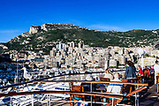 Waterfront view from docked cruise ship of city skyline and mountains, Monte Carlo, Monaco