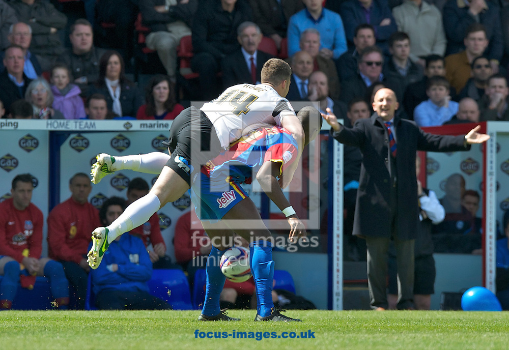 Picture by Alan Stanford/Focus Images Ltd +44 7915 056117.04/05/2013.Wilfried Zaha of Crystal Palace and Tommy Rowe of Peterborough United during the npower Championship match at Selhurst Park, London...
