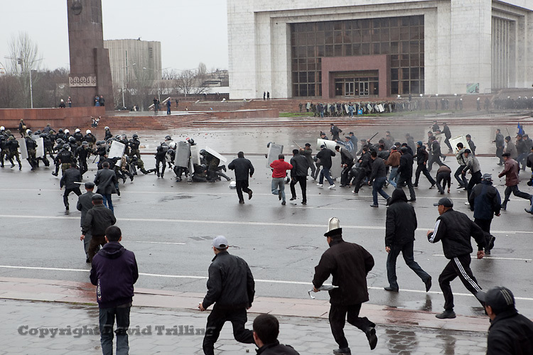 Demonstrators, armed with weapons seized from soldiers, storm the central square in Bishkek calling for the ouster of President Kurmanbek Bakiyev on April 7, 2010.