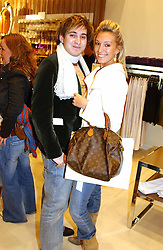 OLIVIA BUCKINGHAM and RICHARD DENNEN at a party to celebrate the opening of the new H&M Flagship Store at 17-21 Brompton Road, London SW3 on 23rd March 2005.<br />