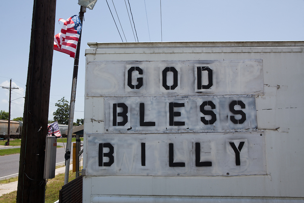 ign supporting Billy Nungesser, the parish president who has become a local hero,  located on highway 23 that goes through Plaquimenes Parish.