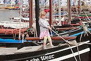 02/07/2012. Córa de Buitléir, Grandaughter of Eamon, helps her dad Cian tie up the Star of the West , Galway Hooker in Galway docks before the arrival of the Volvo Ocean Race boats. Photo:Andrew Downes