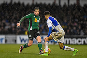 Scunthorpe United Defender, Conor Townsend (22) takes on Bristol Rovers Defender, Daniel Leadbitter (2) during the EFL Sky Bet League 1 match between Bristol Rovers and Scunthorpe United at the Memorial Stadium, Bristol, England on 25 February 2017. Photo by Adam Rivers.
