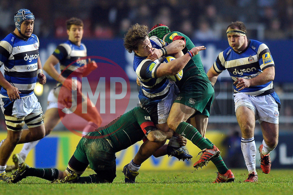 Nick Auterac of Bath Rugby is double-tackled in possession - Photo mandatory by-line: Patrick Khachfe/JMP - Mobile: 07966 386802 04/01/2015 - SPORT - RUGBY UNION - Leicester - Welford Road - Leicester Tigers v Bath Rugby - Aviva Premiership
