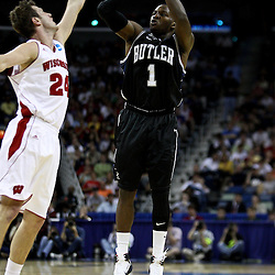 Mar 24, 2011; New Orleans, LA; Butler Bulldogs guard Shelvin Mack (1) shoots over Wisconsin Badgers guard/forward Tim Jarmusz (24) during the first half of the semifinals of the southeast regional of the 2011 NCAA men's basketball tournament at New Orleans Arena.  Mandatory Credit: Derick E. Hingle