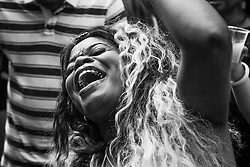 London, August 29th 2016. A woman cannot hide her exuberance as she dances to reggae during day two of Europe's biggest street party, the Notting Hill Carnival.