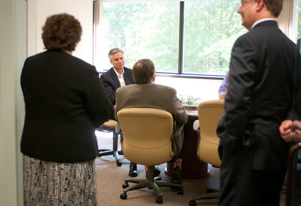Former Ambassador to China and former Utah Gov. Jon Huntsman talks to executives before touring Cirtronics, an employee owned electronic contract assembly company, Milford, NH. 2nd of August 2011.