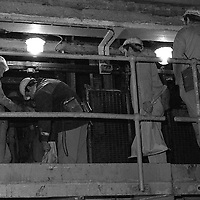 Loading the top deck of the pit cage at Markham Main Armthorpe Colliery. National Coal Board, Doncaster Area 21/06/1983.