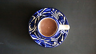 Hot chocolate in a blue and white demi-tasse cup and saucer.