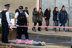 © Licensed to London News Pictures. 11/10/2015. London, UK. Family and friends of the victim being taken to visit the body at the the scene outside the RE bar in Field End Road, Eastcote, Hillingdon where a man was stabbed to death early this morning (SUN). The victim is believed to be  21-year-old Josh Hanson from Kingsbury.  Photo credit: Ben Cawthra/LNP