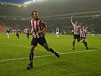 Photo: Andrew Unwin.<br /> Sunderland v Fulham. The Barclays Premiership. 04/05/2006.<br /> Sunderland's Chris Brown (L) celebrates scoring his team's second goal.
