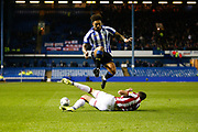 Stephen Ward of Stoke City slide challenges Liam Palmer of Sheffield Wednesday during the EFL Sky Bet Championship match between Sheffield Wednesday and Stoke City at Hillsborough, Sheffield, England on 22 October 2019.