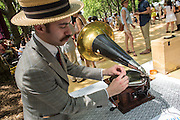 Michael Haar changes a needle on one of the antique phonographs used to play vintage 78s between orchestra sets.