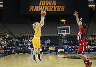 February 11 2013: Iowa Hawkeyes guard Melissa Dixon (21) puts up a shot over Nebraska Cornhuskers guard Brandi Jeffery (13) during the first half of the NCAA women's basketball game between the Nebraska Cornhuskers and the Iowa Hawkeyes at Carver-Hawkeye Arena in Iowa City, Iowa on Monday, February 11 2013.