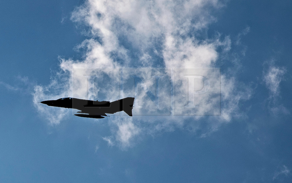 """© licensed to London News Pictures. London, UK 23/06/12. A Turkish F-4 Phantom jet leaves Eskisehir Military Airport on 26/07/11. Today the Syrian military has said it shot down a F-4 Phantom Turkish plane """"flying in airspace over Syrian waters"""". Two crew members are being searched for over the Mediterranean sea. Photo credit: Tolga Akmen/LNP"""