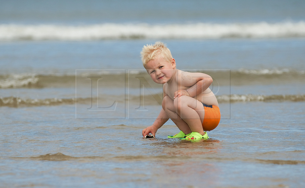 © Licensed to London News Pictures. 24/07/2012..Saltburn Beach, Cleveland, England..As temperatures rise visitors to the beach in the seaside town of Saltburn by the Sea in Cleveland enjoy their day. ..George Carter, 2 and a half plays in the water...Photo credit : Ian Forsyth/LNP