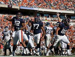 Virginia running back Keith Payne (32) celebrates after scoring a touchdown.  ..The Virginia Cavaliers defeated the Connecticut Huskies 17-16 at Scott Stadium in Charlottesville, VA on October 13, 2007