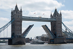 © Licensed to London News Pictures. 30/06/2019. London, UK. A ship passes through Tower Bridge as it raised.The London landmark celebrates its 125th anniversary today and was open on 30 June 1894. Photo credit: Ray Tang/LNP