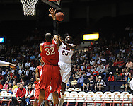 """Ole Miss' Nick Williams (20) vs. Illinois State's Jackie Carmichael (32) in a National Invitational Tournament game at the C.M. """"Tad"""" Smith Coliseum in Oxford, Miss. on Wednesday, March 14, 2012. (AP Photo/Oxford Eagle, Bruce Newman)"""