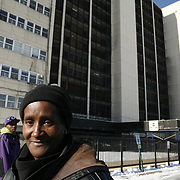 Long time Cabrini Green resident Annie Ricks and her son Raymond Ricks,19, outside their CHA building. The Ricks are the last family to reside in the public housing building behind them. The family moved out Thursday December 9, 2010.<br /> Photography by Jose More