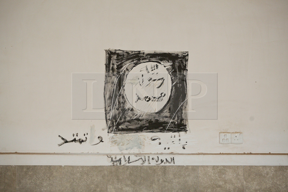 Licensed to London News Pictures. 23/10/2016. The Islamic State flag is seen on a wall of the Mart Shmony Church in the recently liberated town of Bartella, Iraq.<br /> <br /> Bartella, a mainly Christian town with a population of around 30,000 people before being taken by the Islamic State in August 2014, was captured two days ago by the Iraqi Army's Counter Terrorism force as part of the ongoing offensive to retake Mosul. Although ISIS militants were pushed back a large amount of improvised explosive devices are still being found in the town's buildings. Photo credit: Matt Cetti-Roberts/LNP