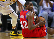April 21, 2012; Indianapolis, IN, USA; Philadelphia 76ers power forward Elton Brand (42) looks to pass the ball off against the Indiana Pacers at Bankers Life Fieldhouse. Philadelphia defeated Indiana 109-106. Mandatory credit: Michael Hickey-US PRESSWIRE