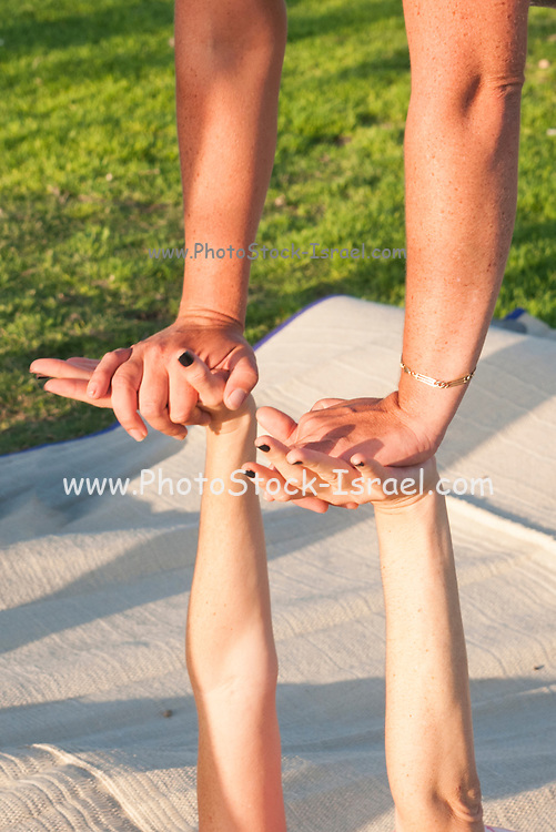 t during an Acro Yoga practice session in Charles Clore Park on the Jaffa shore, Israel