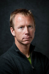 Headshot of Portland based freelance writer, photographer, and outdoor guide Bennett Barthelemy