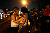 Two white women lead two black  women in prayer at the site of last year's riots on the one year anniversary of the killing of Michael Brown Jr. in Ferguson, Missouri August 9, 2015.  Several hundred people gathered in Ferguson, Missouri, on Sunday to mark the one-year anniversary of the shooting death of an unarmed black teenager by a white police officer that sparked protests and a national debate on race and justice.  REUTERS/Rick Wilking