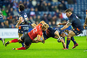 Tertius Kruger (#12) of Isuzu Southern Kings tackles Jamie Ritchie (#6) of Edinburgh Rugby during the Guinness Pro 14 2018_19 rugby match between Edinburgh Rugby and Isuzu Southern Kings at the BT Murrayfield Stadium, Edinburgh, Scotland on 5 January 2019.