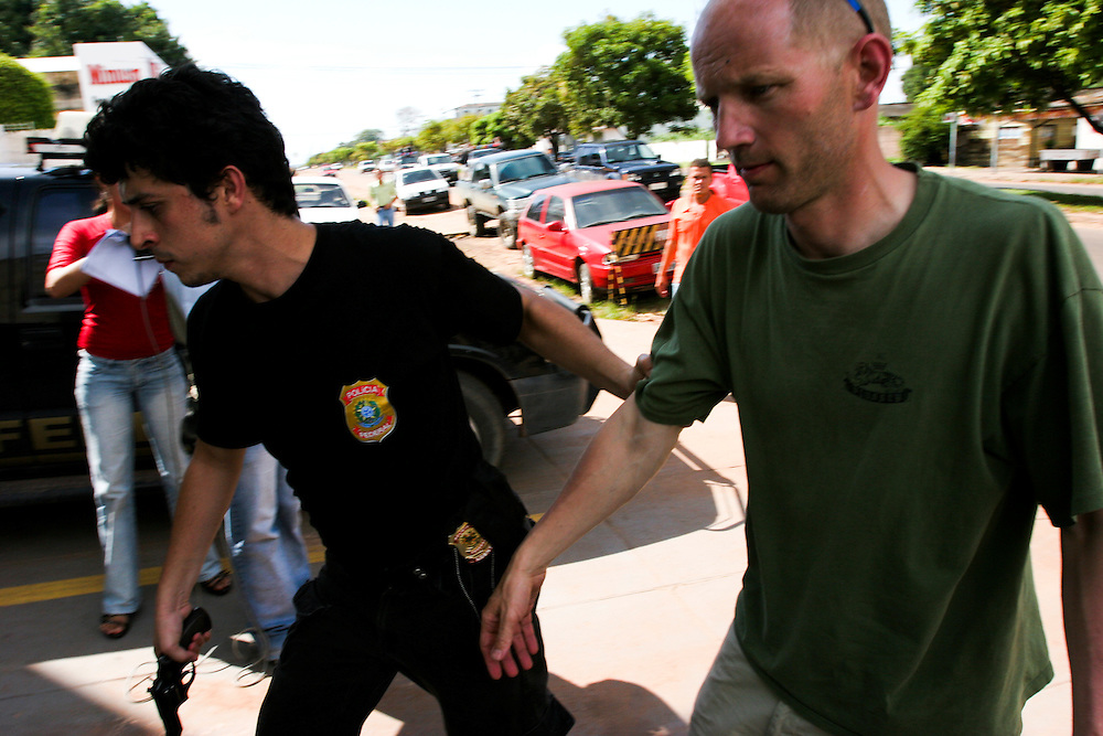 May 19th 2006. Santarem (Para State, Brazil)..Arrested activists arriving at Santarem Federal Police headquarters after Greenpeace ship MY Arctic Sunrise blocked the discharge of a barge loaded with soya at Cargill facility . Soya expansion is one of the leading causes of deforestation in the Amazon.
