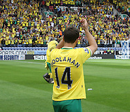 Norwich's Wes Hoolahan applauds the traveling fans as he enters the field of play before the Barclays Premier League match at the DW Stadium, Wigan...Picture by Paul Chesterton/Focus Images Ltd. .07904 640267.13/8/11